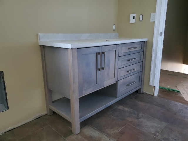 Grey vanity with Mont Blanc laminate countertop
