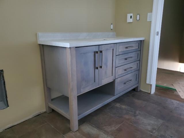 Grey vanity with Mont Blanc laminate countertop