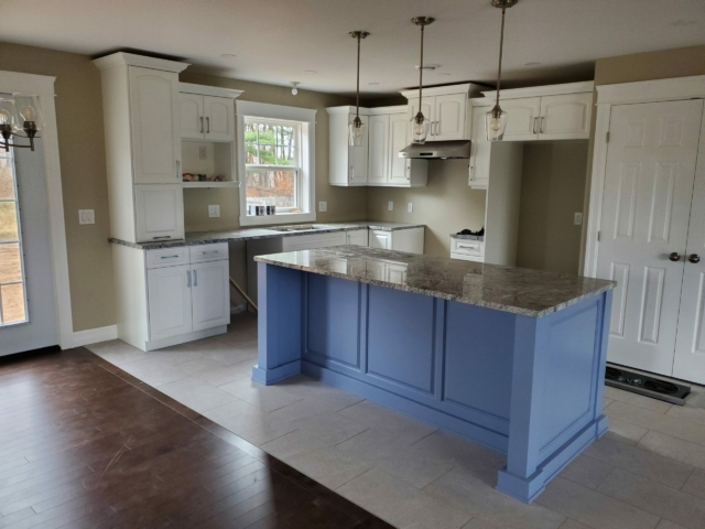 Painted kitchen with Silver Cloud Granite Countertops